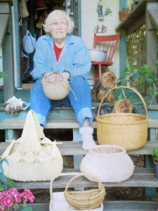 Mae Taylor at home with her baskets and her helpers. (Photo courtesy Susan Taylor)