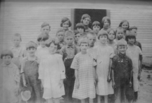 In the schoolyard in the 1930s. Mr. Burgin is third row, second from the left.