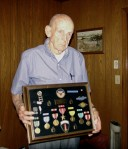 Mr. Burgin proudly displays his medals from WWII.